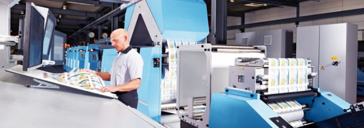 Worker using Rexroth printing equipment