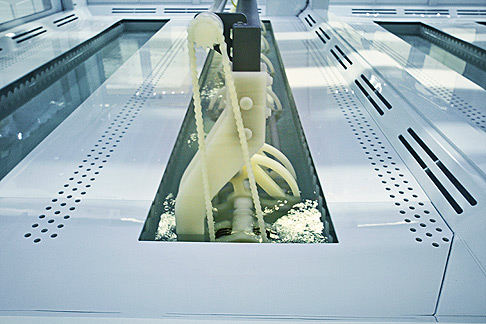 Rexroth Cartesian Robot positions a basket of polysilicon chunks into a wet processing bath.